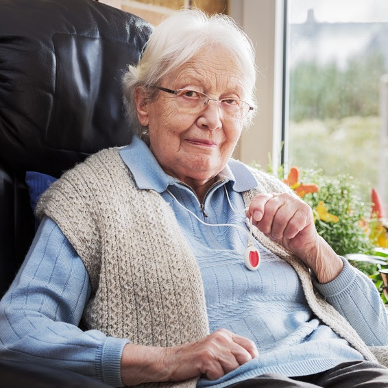 Elderly person with emergency button
